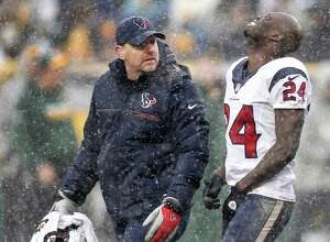 Houston Texans cornerback Johnathan Joseph (24) walks off the field with trainer Geoff Kaplan after suffering an injury during the third quarter of an NFL football game against the Green Bay Packers at Lambeau Field on Sunday, Dec. 4, 2016, in Green Bay.