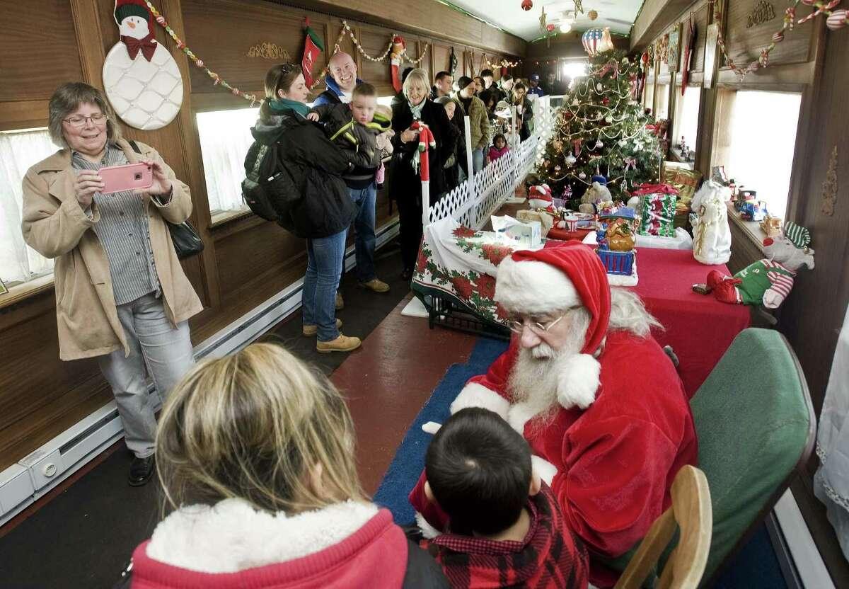 Visitors line up to meet with Santa Claus at the Danbury Railway Museum's Santa Train Ride. Sunday, Dec. 4, 2016