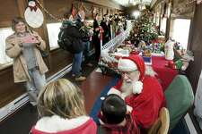 Visitors line up to meet with Santa Claus at the Danbury Railway Museum's Santa Train Ride. Sunday, Dec. 4, 2016