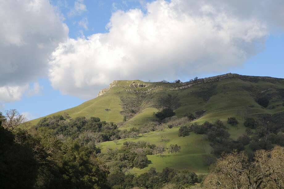 Looking up at 1,360-foot Flag Hill, one of several sites in Sunol Regional Wilderness with historic rock outcrops where bandits from the 1850s in the gold rush may have found or developed forts as hideouts. Photo: Tom Stienstra, Tom Stienstra / The Chronicle