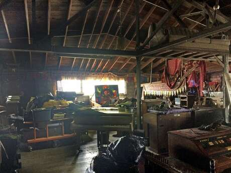 This 2014 photo provided by Ajesh Shah shows the interior of a portion of the 'Ghost Ship' warehouse, taken while he was on a tour as a potential tenant of the Oakland, Calif., building. Dozens of people have died at a party after a fire that started late Friday, Dec. 2, 2016, and swept through the building. (Ajesh Shah via AP)