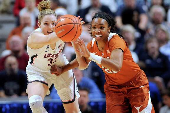 It's a race for a loose ball as Connecticut's Katie Lou Samuelson, left, and Texas' Brianna Taylor scramble in the first half of Sunday's game at Uncasville, Conn.
