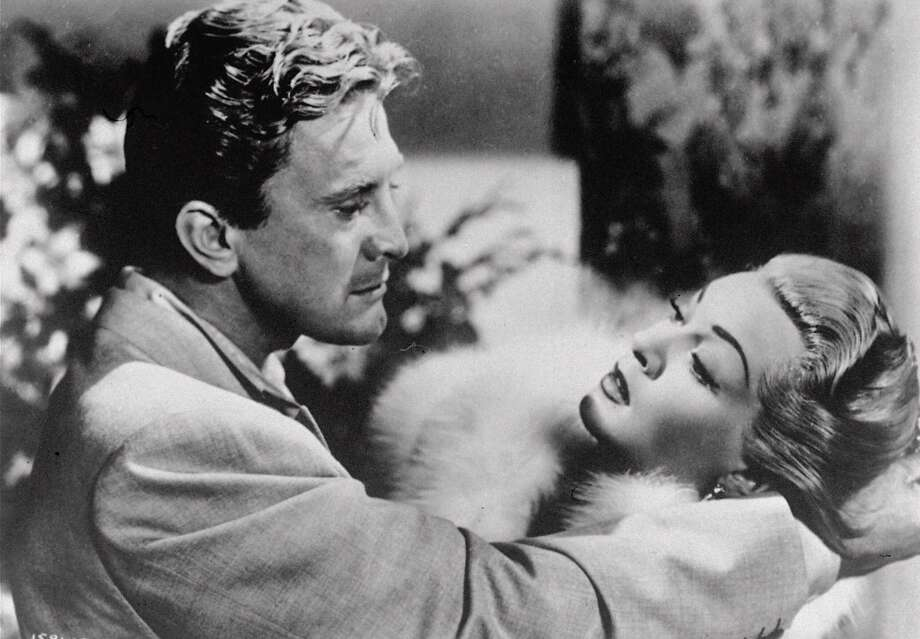 """Kirk Douglas and Lana Turner in Vincente Minnelli's """"The Bad and the Beautiful"""" (1952). Douglas received one of his three Academy Award nominations for his performance. Photo: Associated Press"""