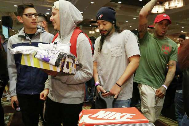 Robert Paredes passes through the crowd of sneaker lovers with his wagon full of sneakers at H-Town Sneaker Summit Sunday, Dec. 4, 2016, in Houston. It was Paredes' first time to participate the summit and he wanted to trade and buy sneakers. ( Yi-Chin Lee / Houston Chronicle )