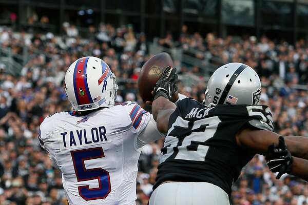 OAKLAND, CA - DECEMBER 04:  Khalil Mack #52 of the Oakland Raiders tips a pass from Tyrod Taylor #5 of the Buffalo Bills during their NFL game at Oakland Alameda Coliseum on December 4, 2016 in Oakland, California.  (Photo by Brian Bahr/Getty Images)