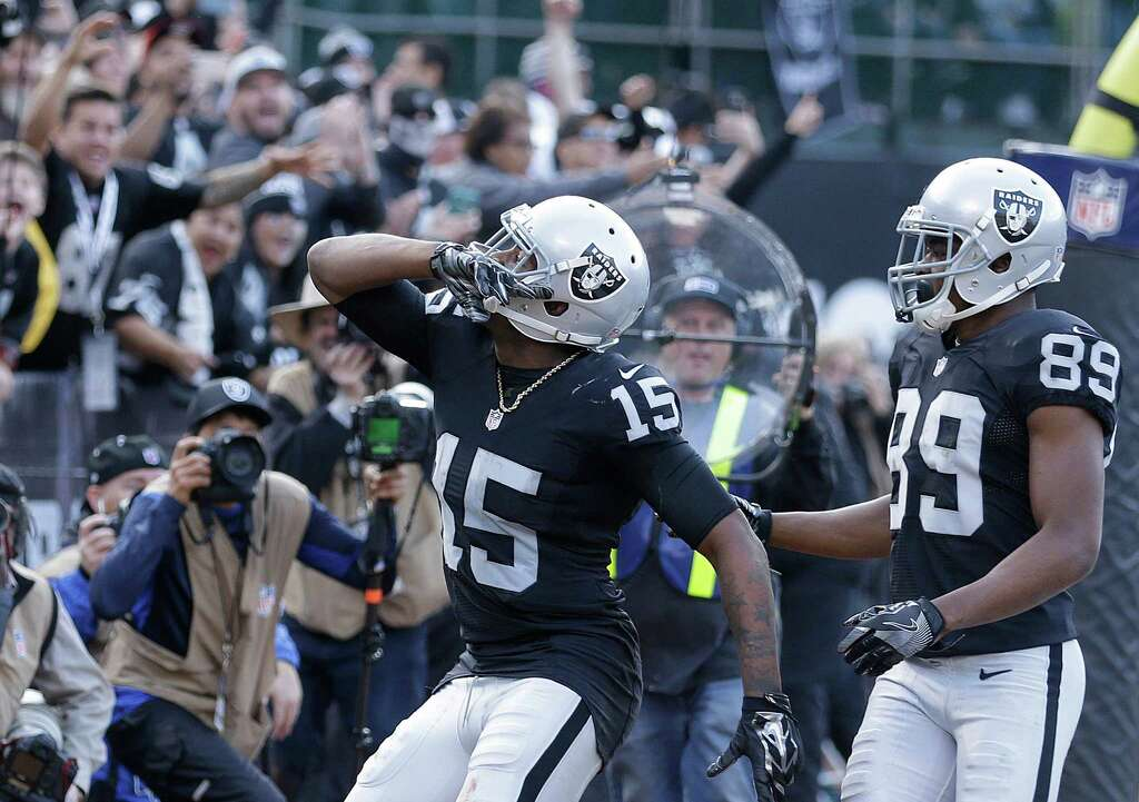 8bfb5e279 ... Oakland Raiders wide receiver Michael Crabtree (15) celebrates after  scoring a touchdown with wide ...