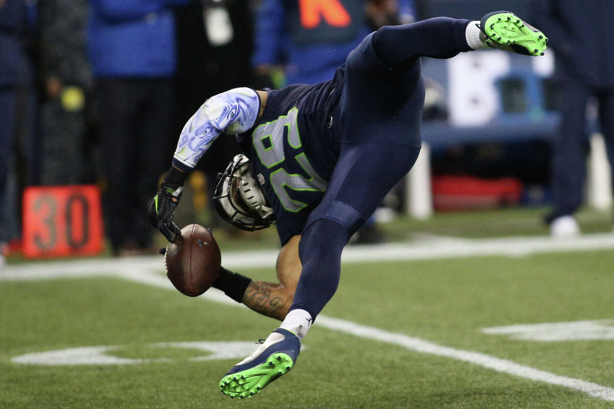 Seahawks safety Earl Thomas falls the to ground trying to hold onto an interception in the first half against the Panthers at CenturyLink Field on Sunday, Dec. 4, 2016. Thomas walked off the field and left the game.