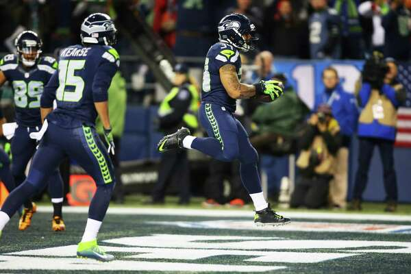 Seahawks running back Thomas Rawls scores a touchdown in the first quarter of the Seahawks game against the Carolina Panthers, Sunday, Dec. 4, 2016, at CenturyLink Field.