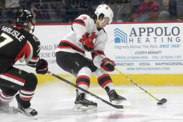Joe Blandisi, right, with the Albany Devils brings the puck around a Binghamton Senators player during their game on Sunday, Dec. 4, 2016, in Albany, N.Y.   (Paul Buckowski / Times Union)