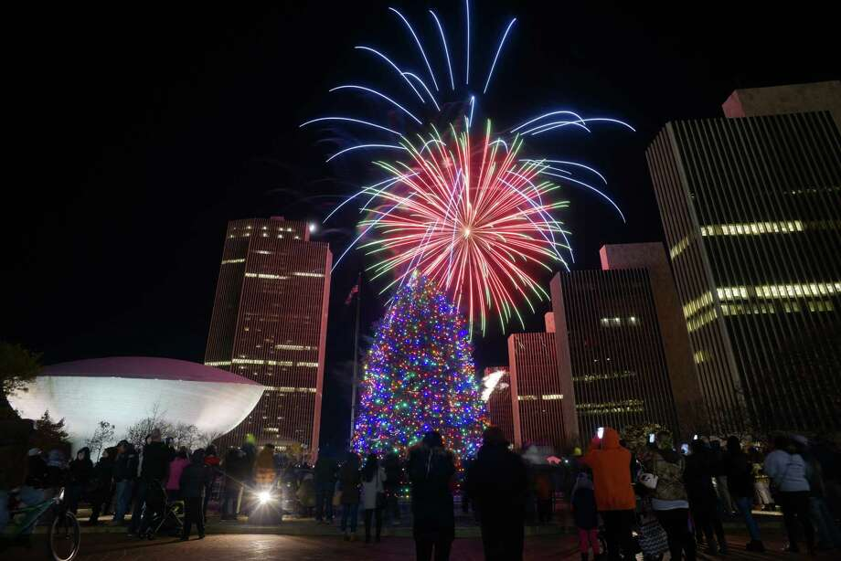 Fireworks explode in the sky over the Empire State Plaza during the New York State Tree Lighting and Fireworks celebration on Sunday, Dec. 4, 2016, in Albany, N.Y.  (Paul Buckowski / Times Union) Photo: PAUL BUCKOWSKI / 20038791A