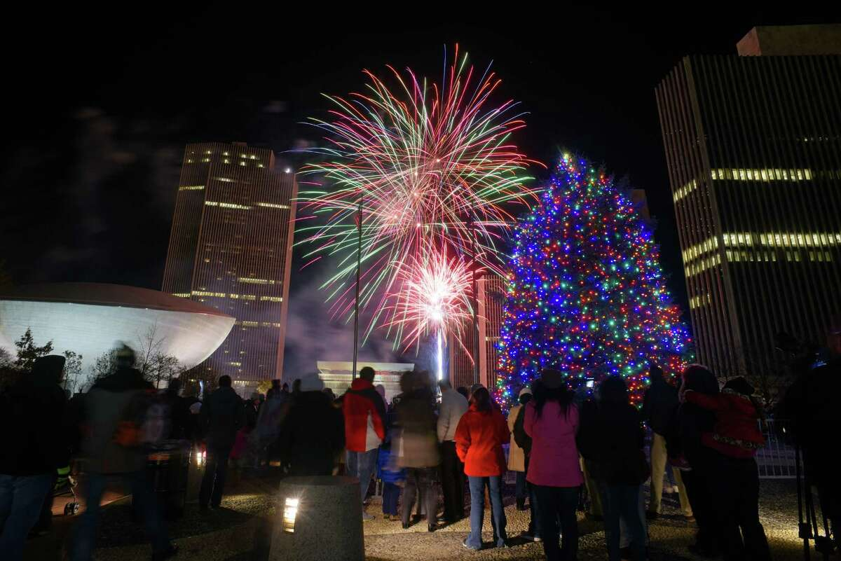 Fireworks explode in the sky over the Empire State Plaza during the New York State Tree Lighting and Fireworks celebration on Sunday, Dec. 4, 2016, in Albany, N.Y. (Paul Buckowski / Times Union)