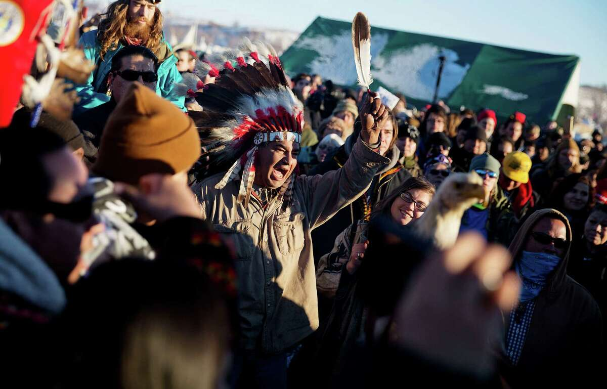 A crowd gathers in celebration at the Oceti Sakowin camp after it was announced that the U.S. Army Corps of Engineers won't grant easement for the Dakota Access oil pipeline in Cannon Ball, N.D., Sunday, Dec. 4, 2016. (AP Photo/David Goldman) ORG XMIT: NDDG117