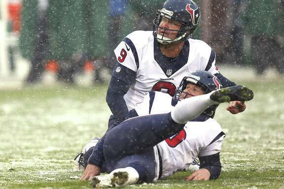 Texans kicker Nick Novak slips to the turf while missing an extra point in the fourth quarter of Sunday's loss at Green Bay.