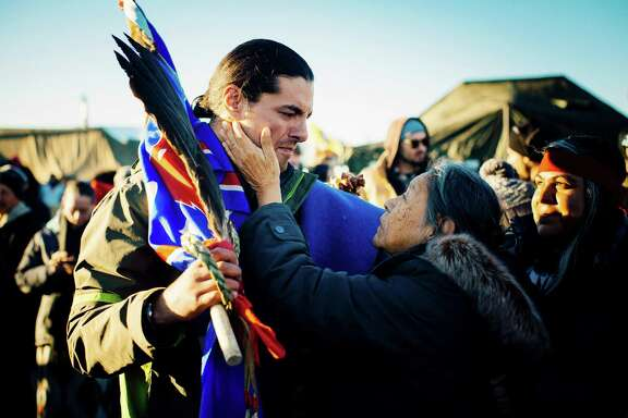 Maida Le Beau embraces Bobby Robedeaux after hearing the latest on the Dakota Access pipeline.