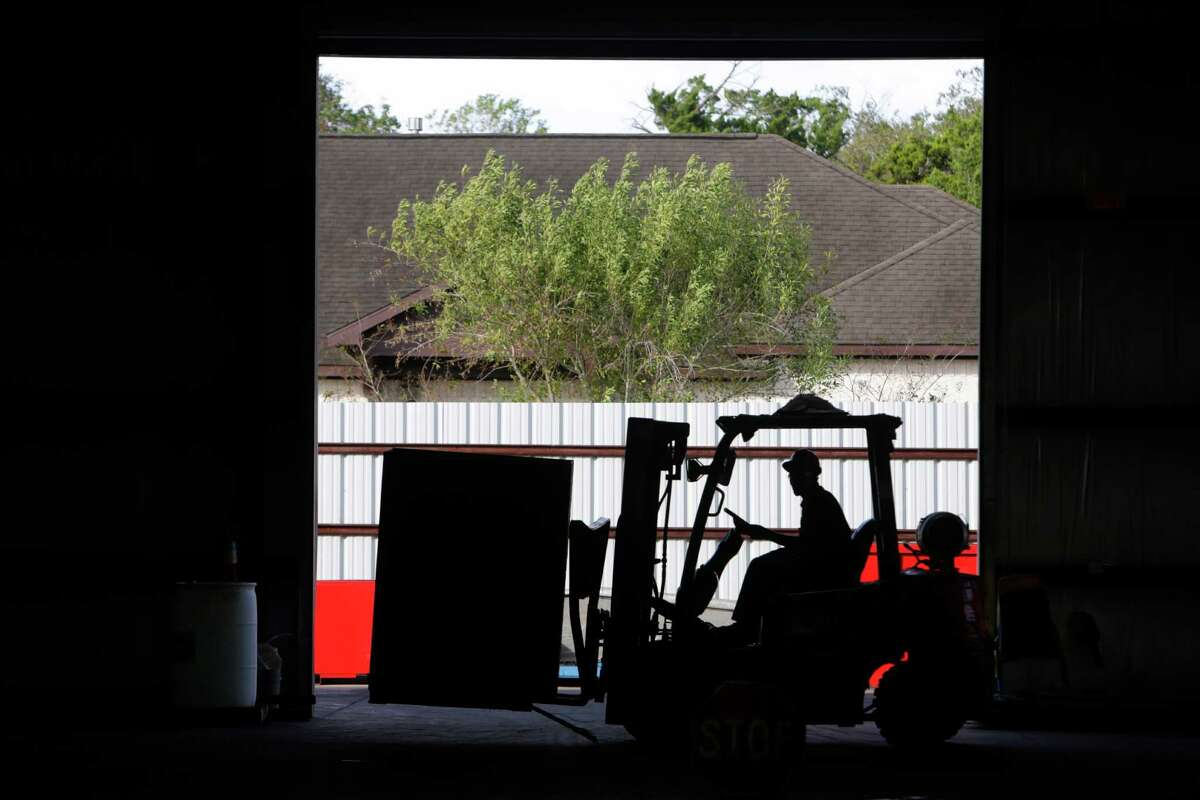 Scrapyards such as South Post Oak Recycling Center, where all manner of metals from gutters to street signs are collected, have been hit by a drop in commodity prices over the past several years.