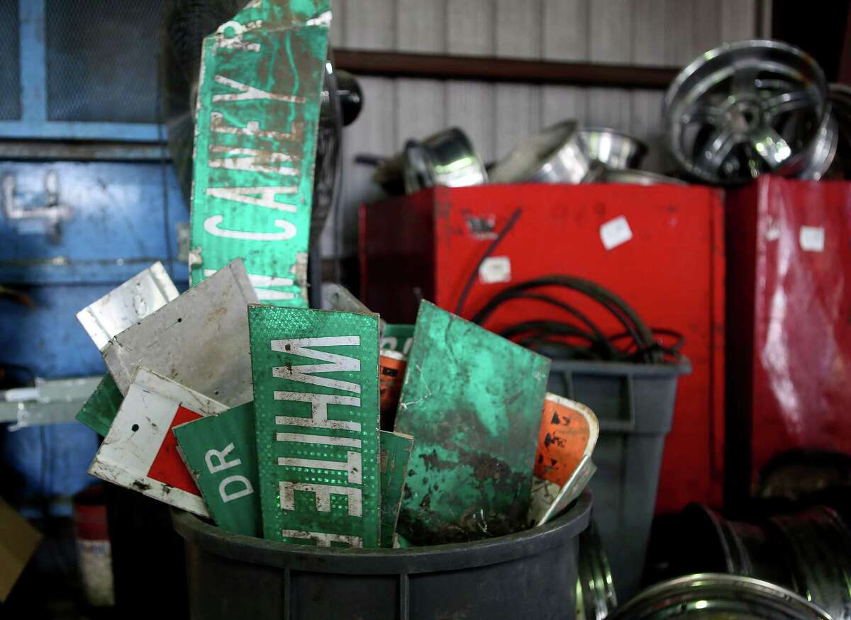 A load of old street signs waits to be processed at South Post Oak Recycling Center, Monday, Nov. 21, 2016, in Houston. The recycling center has contracts with certain municipalities and won't take city property like signs from anyone who comes into the center. (Mark Mulligan / Houston Chronicle )