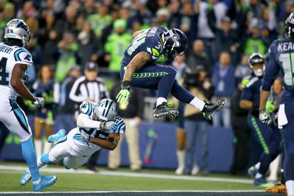 Seattle's Thomas Rawls leaps into the end zone for a touchdown Sunday against Carolina. Rawls ran for two scores in the first half of the Seahawks' 40-7 win.
