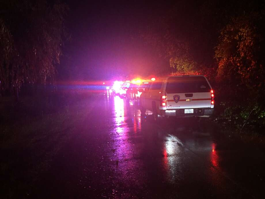 Emergency crews were dispatched to 8400 Quintana Road at about 7:30 p.m., when they found two cars submerged inside a sinkhole. Photo: Quixem Ramirez
