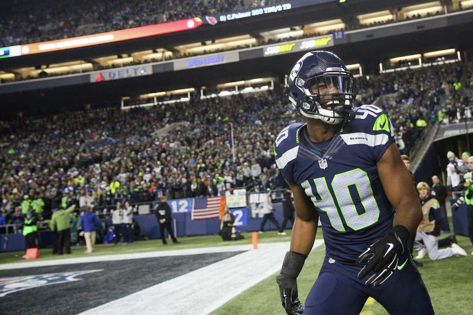 Seahawks safety Tyvis Powell smiles as he runs off the field following a punt return in the second half while playing the Panthers at CenturyLink Field on Sunday, Dec. 4, 2016.   Photo: GRANT HINDSLEY, SEATTLEPI.COM / GRANT HINDSLEY