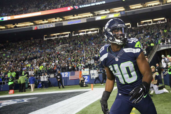 Seahawks safety Tyvis Powell smiles as he runs off the field following a punt return in the second half while playing the Panthers at CenturyLink Field on Sunday, Dec. 4, 2016.
