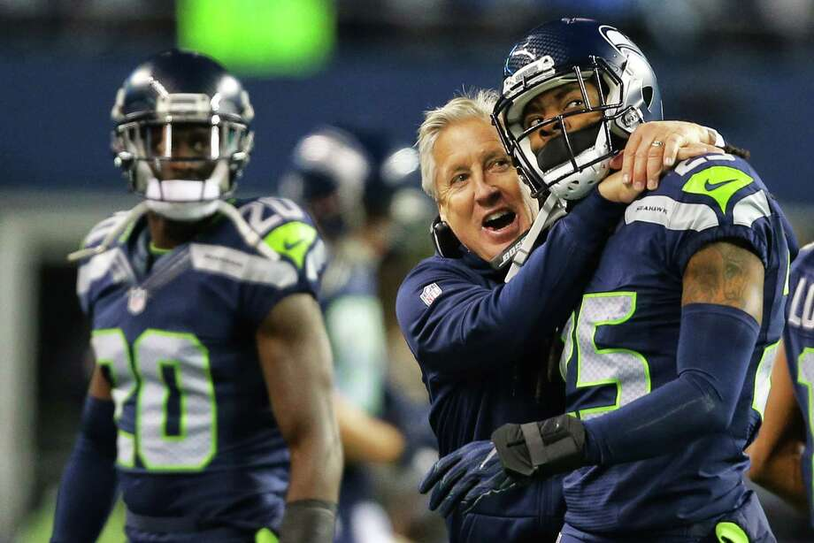 Head coach Pete Carroll celebrates with Seahawks corner back Richard Sherman after the defense recovered a ball fumbled by Panthers running back Jonathan Stewart during the first half of the Seahawks game against the Carolina Panthers, Sunday, Dec. 4, 2016, at CenturyLink Field. Photo: SEATTLEPI.COM / SEATTLEPI.COM