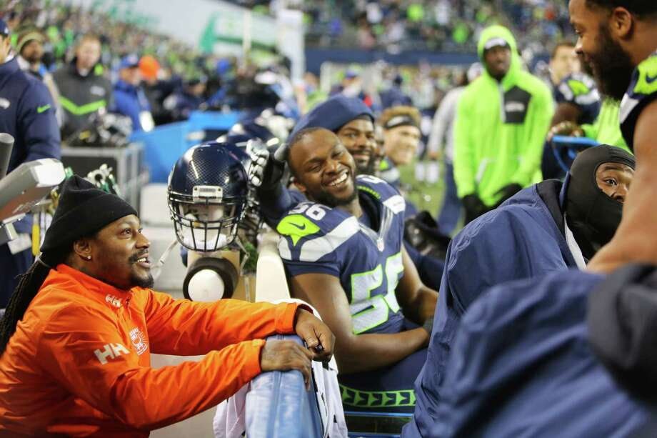 Former Seahawks running back Marshawn Lynch chats with Seahawks Michael Bennett and Cliff Avril on the sideline during the second half of the Seahawks game against the Carolina Panthers, Sunday, Dec. 4, 2016, at CenturyLink Field. Photo: SEATTLEPI.COM / SEATTLEPI.COM