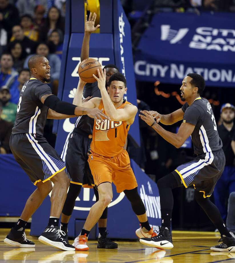 Golden State Warriors' David West, Ian Clark and Shaun Livingston surround Phoenix Suns' Devin Booker in 2nd quarter during NBA game at Oracle Arena in Oakland, Calif., on Saturday, December 3, 2016. Photo: Scott Strazzante, The Chronicle