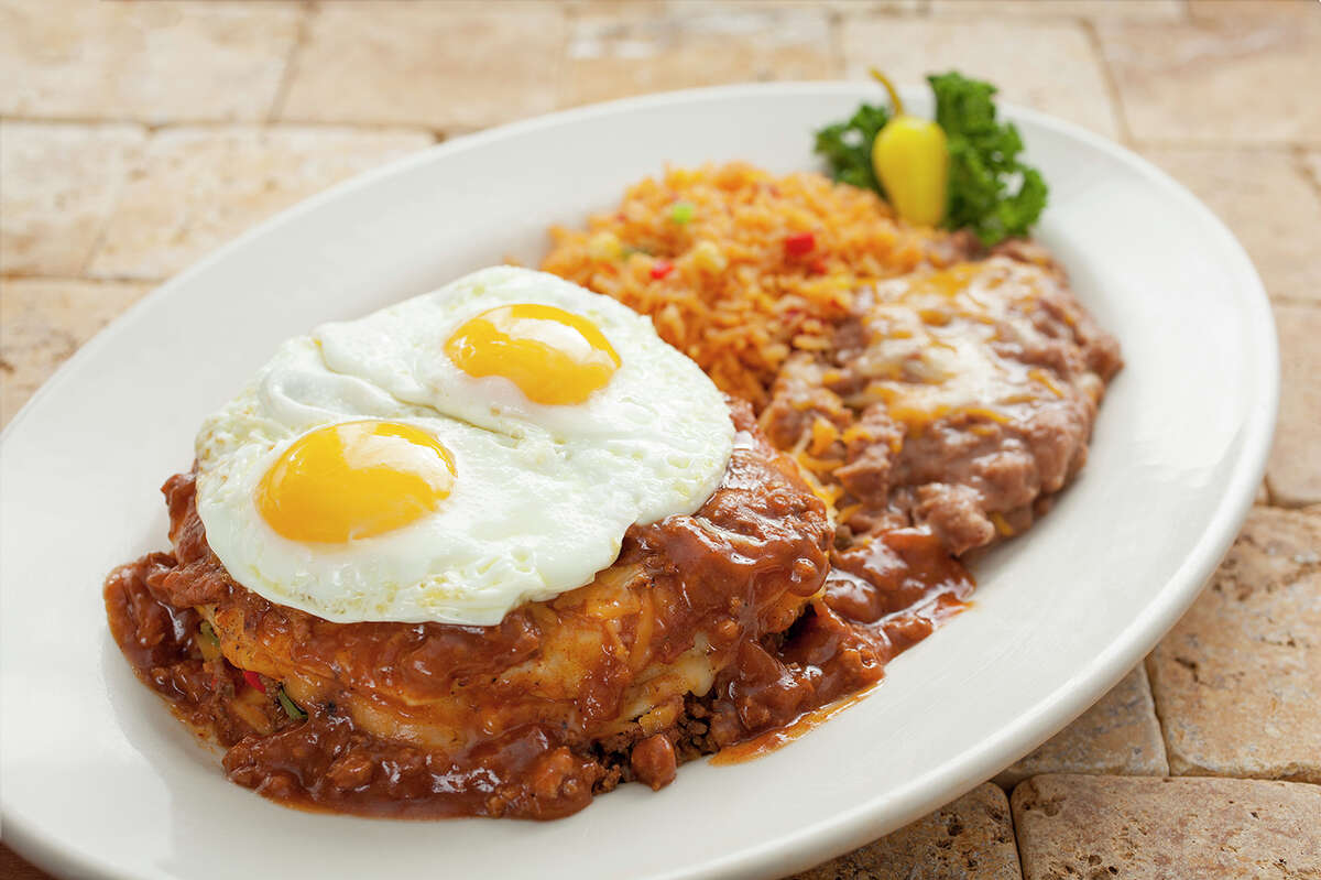 Abuelo's Mexican restaurant will open its first location in the Houston area in Katy in February 2017. Shown: Mi Abuelo's Manjar (three stacked enchiladas with beef, cheese, and chile con carne topped with two eggs).