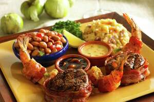 Abuelo's Mexican restaurant will open its first location in the Houston area in Katy in February 2017. Shown: Los Mejores de la Casa (fire-grilled, bacon-wrapped beef tenderloin medallions and bacon-wrapped shirmp stuffed with fresh jalapeno and cheese.