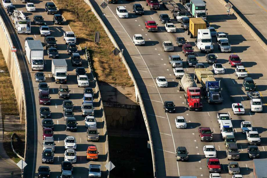 Southbound traffic on I-45 jams both the main lanes and the service road due to construction on the interchange with the Grand Parkway near the new Exxon Mobil corporate just south of The Woodlands on May 23, 2013. Photo: Smiley N. Pool, Houston Chronicle / © 2014  Houston Chronicle