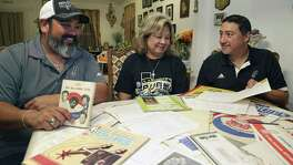 Chris (from left), Juanita and Adam Montalvo look over some Spurs memorabilia.