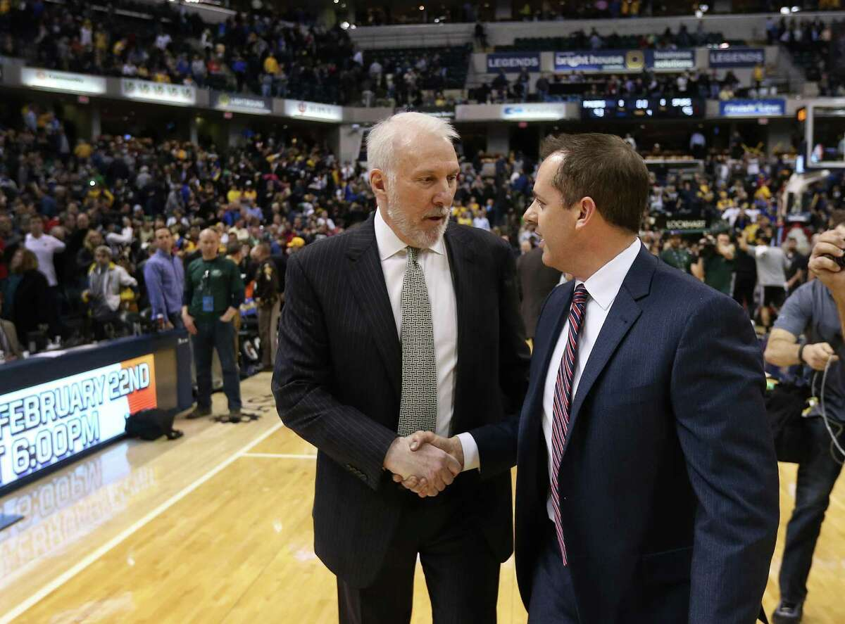 """Frank Vogel (right) congratulates Gregg Popovich after a Spurs road victory over Indiana in 2015. Said Vogel, now with Orlando: """"Coach Pop? He's the godfather."""""""