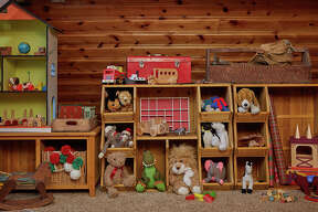 Built-in shelving stores lots of toy prototypes.  ( Zillow )
