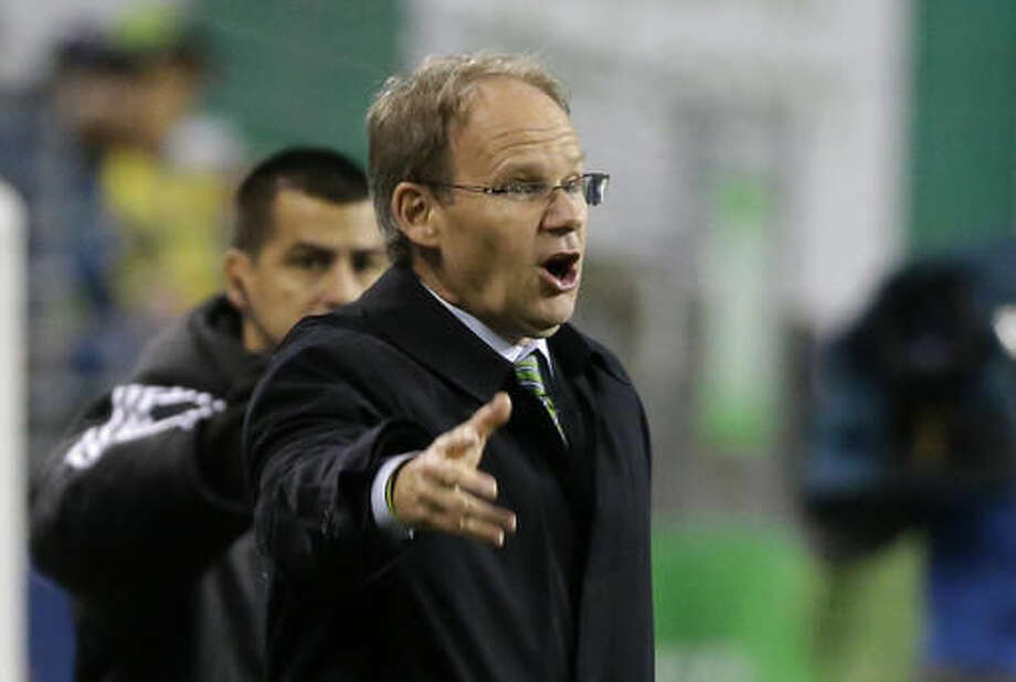 Seattle Sounders interim head coach Brian Schmetzer reacts on the sideline during the second half of an MLS soccer playoff match against Sporting Kansas City, Thursday, Oct. 27, 2016, in Seattle. The Sounders beat Sporting Kansas City 1-0. (AP Photo/Ted S. Warren)