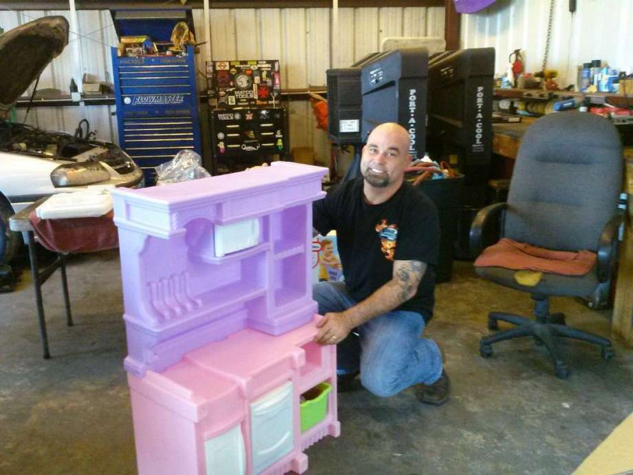 Best Automotive in Kingwood employees will assemble toys free of charge for parents before Christmas.