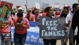 Hundreds march toward the immigrant detention center in Dilley during a protest in May 2015. Federal officials unexpectedly released nearly 500 women and children over the weekend, apparently in response to a recent court decision prohibiting the state from licensing the center as a daycare facility.