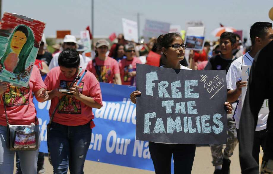 Hundreds march toward the immigrant detention center during march and protest in Dilley, Texas on Saturday, May 2, 2015. (Kin Man Hui/San Antonio Express-News) Photo: Kin Man Hui, Staff / San Antonio Express-News / ©2015 San Antonio Express-News