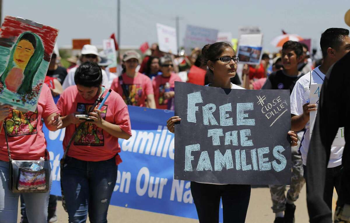 Hundreds march toward the immigrant detention center during march and protest in Dilley, Texas on Saturday, May 2, 2015. (Kin Man Hui/San Antonio Express-News)