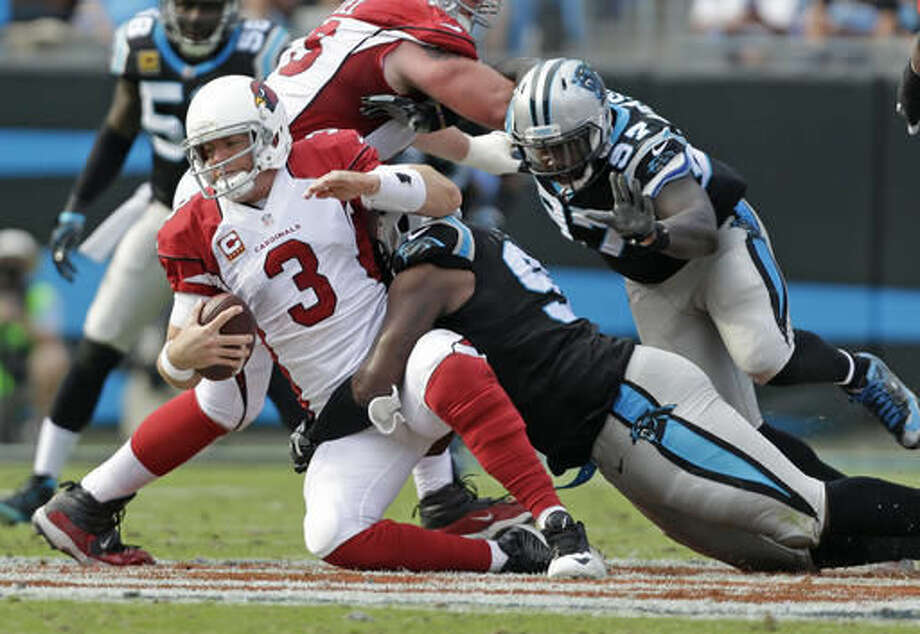 Arizona Cardinals' Carson Palmer (3) is sacked by Carolina Panthers' Kawann Short (99) in the second half of an NFL football game in Charlotte, N.C., Sunday, Oct. 30, 2016. (AP Photo/Bob Leverone)