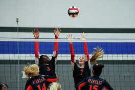 Bellaire's Megan Evans (3) and Bellaire's Annika Bohmann (7) put up a block against Seven Lakes during the BSN/Under Armour CCISD Volleyball Tournament at Clear Springs High School on Thursday, Sept. 1.