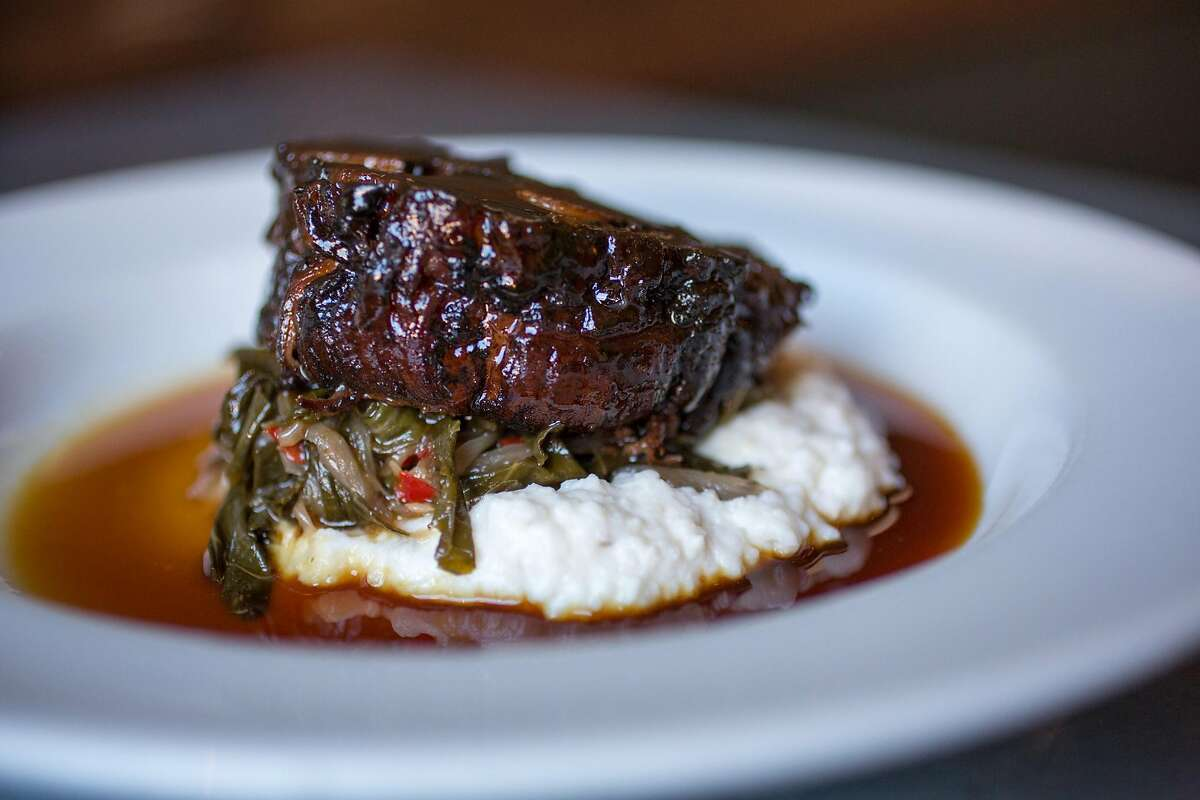 This is the Coffee rubbed pork shoulder creamy hominy and collard greens photographed at Range in San Francisco Calif., Friday March 27, 2015.