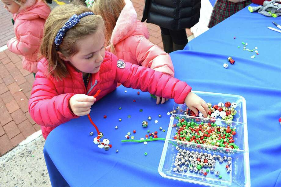 Amelia Denny, 4, of New Canaan, does some holiday beading work at the Holiday Stroll, Saturday, Dec. 3, 2016, in New Canaan, Conn. Photo: Jarret Liotta / For Hearst Connecticut Media / New Canaan News Freelance