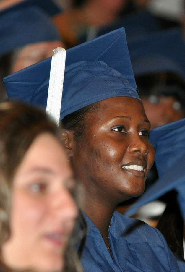 Darline Gaspard, of Stratford, listens during the 2010 St. Vincent's College Commencement Ceremony held at the Regina A. Quick Center at Fairfield University on Friday, May 21, 2010. Photo: Amy Mortensen / Connecticut Post Freelance