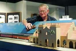 Rusty Paulus serves as the volunteer caretaker of the S gauge model train exhibit at the Alvin Historical Museum Tuesday, Nov. 22.