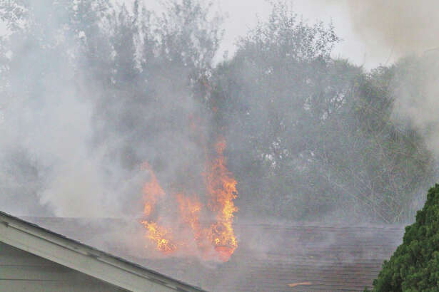 Firefighters work to extinguish a house fire in the 14000 block of Fruitwood in Southeast Houston Sunday, December 4.
