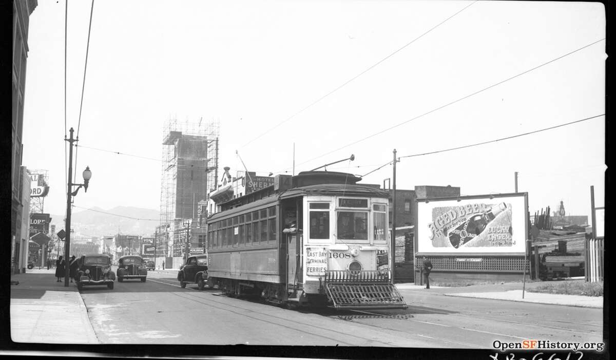 Mission St. near 11th St. 1953, 14-line MSRY 1608, Coca Cola Tower under construction, Hotel Sherman 87 11th Street, looking west on Mission, Twin Peaks in background. Courtesy of OpenSFHistory.org.