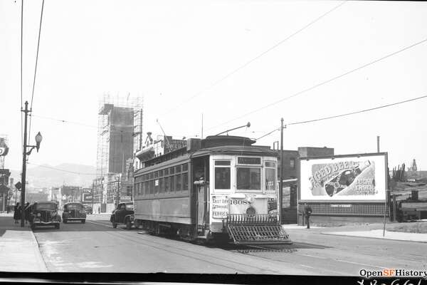 Mission St. near 11th St. 1953, 14-line MSRY 1608, Coca Cola Tower under construction, Hotel Sherman 87 11th Street, looking west on Mission, Twin Peaks in background. Courtesy of  OpenSFHistory.org .