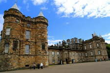 This photo taken June 25, 2016, shows the front of Holyrood Palace, the royal residence in Edinburgh. The palace features elegantly decorated salons as well as the chambers where Mary Queen of Scots once lived. (Michelle Locke via AP)