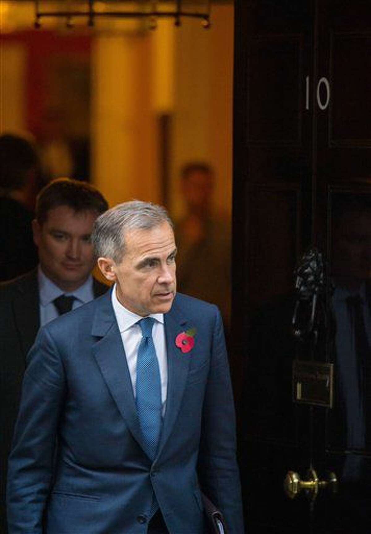 Bank of England governor Mark Carney leaves No.10 Downing Street, London, Monday Oct. 31, 2016, after a regular meeting. Britain's government is offering strong support for Bank of England's Mark Carney amid speculation that he'll soon announce whether he'll serve his full term as governor. (Dominic Lipinski/PA via AP)