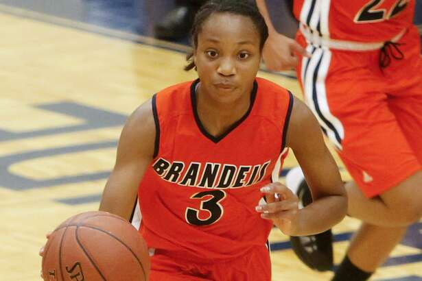 Brandeis' Gabby Connally brings the ball up the court during at ataylor Field House in 2013.